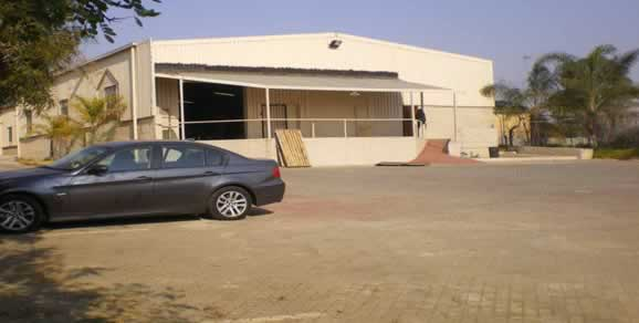 The factory building itself is 1000m2 and has an additional 230m2 of